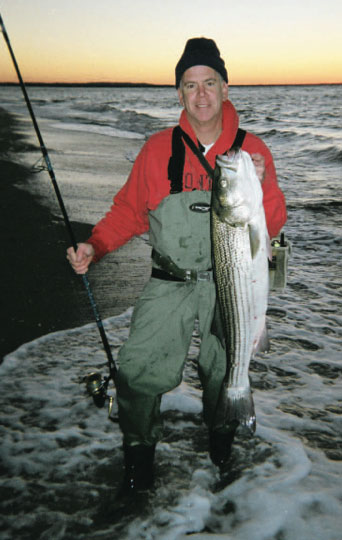 The author with a 19-pound bass. Seek out areas with white water, these offer prime habitat for hungry stripers.