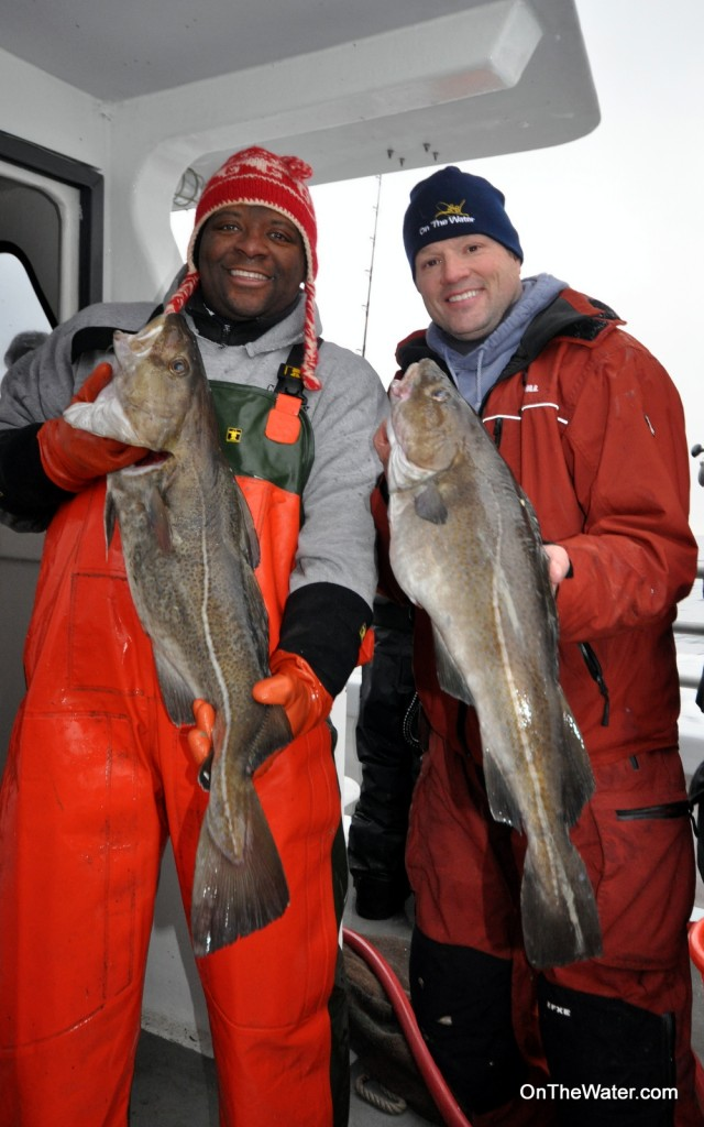First mate Randy Brown (left) and Chris Megan showed off a couple of keeper cod at the end of the trip. By occasionally leaving a rod unattended in a rod holder, Randy outfished the editorial staff of OTW.