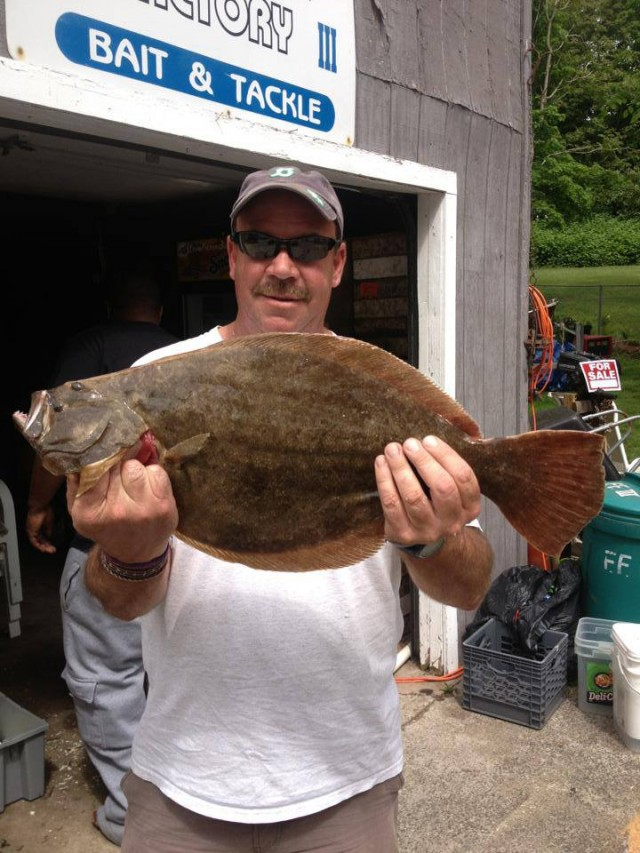 Scott Romano picked up this 5.7-pound fluke on Wednesday morning off the backside of Fisher's Island.