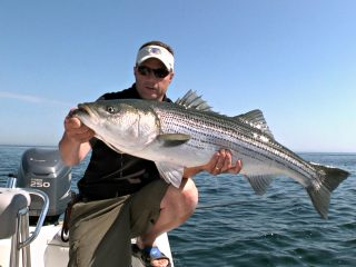 Chris Megan with striped bass