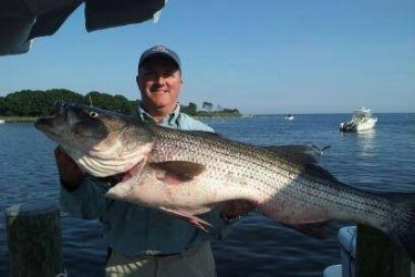 Sam Orr with a hefty Block Island striper.