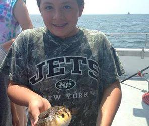 Jake Butkevitch, 12, caught this puffer while at the Kids Fishing Fun Camp aboard the Celtic Quest.