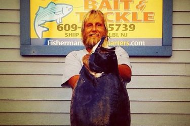 Robert Davis of Bamber Lakes with his 15.3-pound fluke.