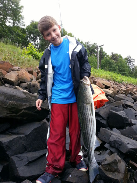 Dillon McDonald with his first keeper striper caught in the Cape Cod Canal.