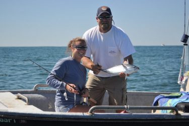 Courtney Darenberg of Montauk Marine Basin is all smiles after catching a false albacore off Montauk on Wednesday.