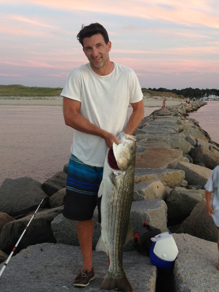 """Brian O'Neill caught his personal best 44"""" striper from a jetty in Dennis this week."""