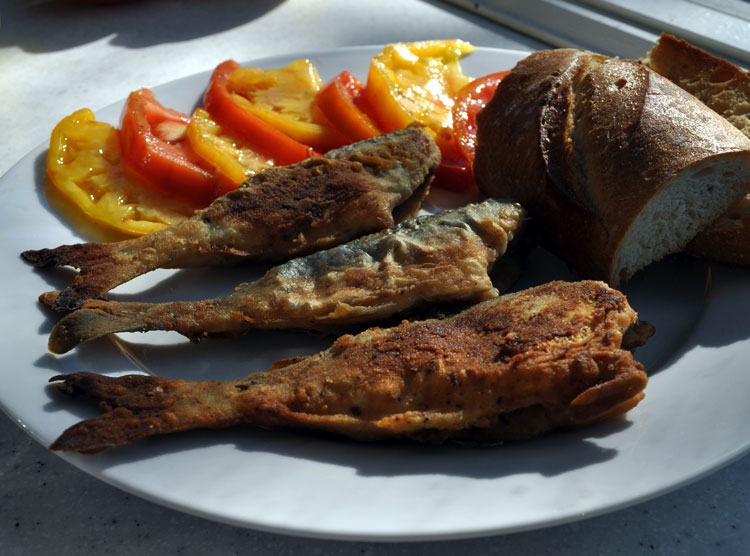 Pan-fried until golden brown, snapper blues match well with the season's ripe garden tomatoes.