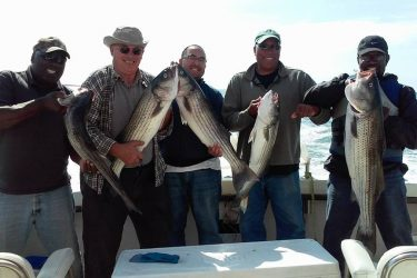 Pictured is a happy bunch aboard The Otter. Captain Bruce still has an opening for Halloween, call 860-235-6095 to book a trip!