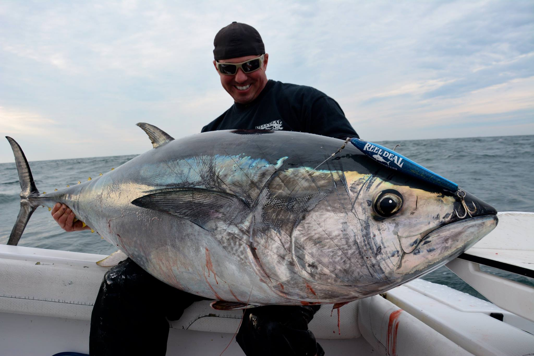 Reel Deal charters shared this photo of Capt. Mike Wisniewski with a topwater bluefin tuna caught this week.