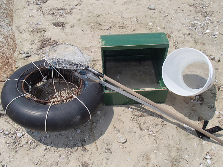 The tools of the trade, including a pair of custom made viewers. A 5-gallon bucket with the bottom removed and a piece of Plexiglas glued in makes a suitable viewer, but a wooden box with a partial hood is even better.