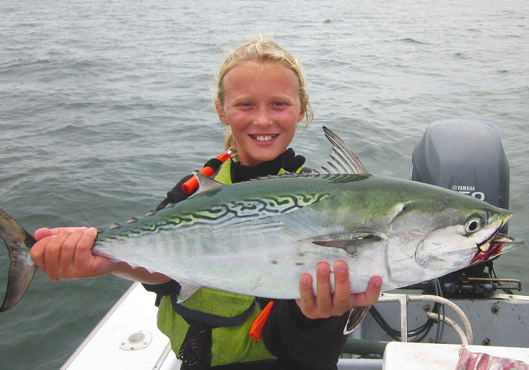 Annie Fey holds a Nantucket albie. False albacore are usually available in island waters through the month of october.