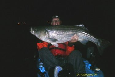 Mark Phillips of Wethersfield CT with a 47-pound striper taken via kayak.