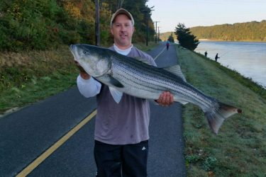 Dan West shows off a 32-pound bass caught at the Canal on Saturday morning.