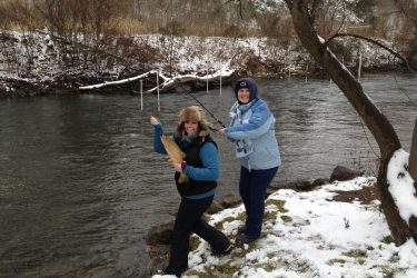 """Katie Nihart and Dawn Peachey caught quite a few trout while fishing with fellow co-workers Dave Nihart and John Sinclair on Spring Creek.  Pictured here is a big Rainbow Trout that added to a great day of fishing.  Several trout between 12-18"""" were caught.  The successful lure was a size F05 rapala with a black back and yellow belly.  Congratulations to Katie and Dawn on their great catch!"""