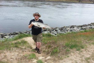 Colin Daley with a 31-inch striper from the Canal on his first trip to the Ditch in years.