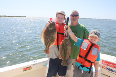 Captain Brett put these happy clients on some keeper fluke this week.