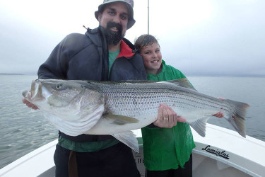 9-year-old Jacob with his first cow bass aboard Reel Cast Charters
