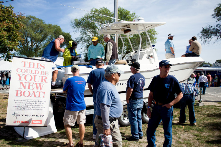 StriperFest attendees check out the Grand Prize Striper Boat and Yamaha Engine outfitted with Simrad Electronics.
