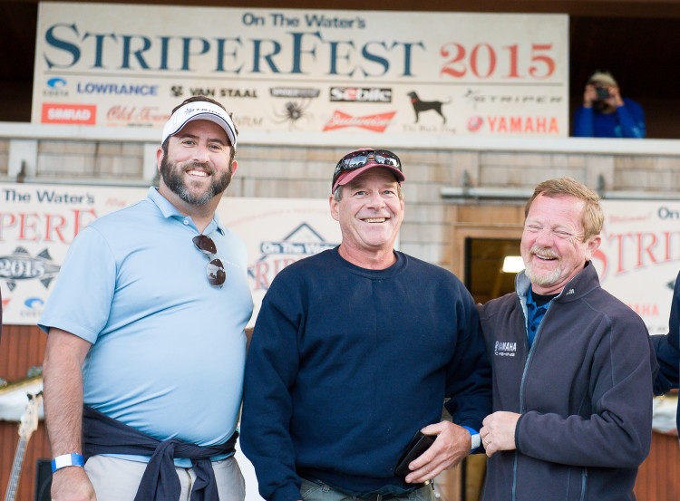 Grand Prize Winner Joe Dyer (center) of Salem, Massachusetts is congratulated by Matthew Ventzer of Striper Boats (left) and Dave Ittner of Yamaha (right).