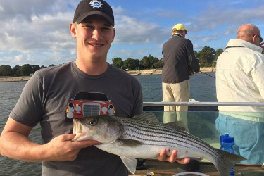 William Ewert with a good striped bass.