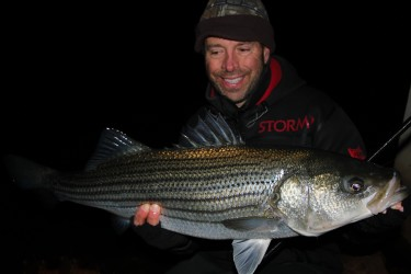 The author with an 18½-pound December holdover striped bass he landed on Shimano's Long Cast Surf System in Boston Harbor.