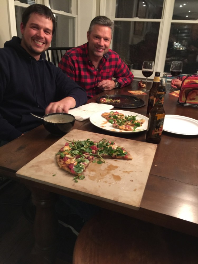 Jimmy Fee and Chris Megan chow down on the Dalat-inspired sashimi pizza.