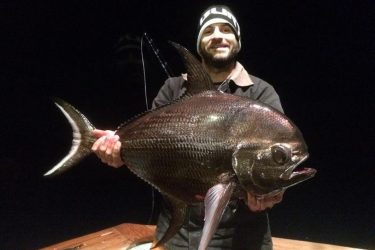 Marcel Israel with a bigscale pomfret that ate a swordfish bait in Hudson Canyon last week.
