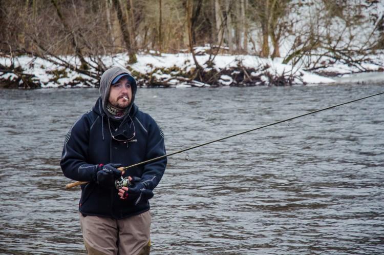 Ryan Bibeau keeps his eyes on the float as it drifts down-river.