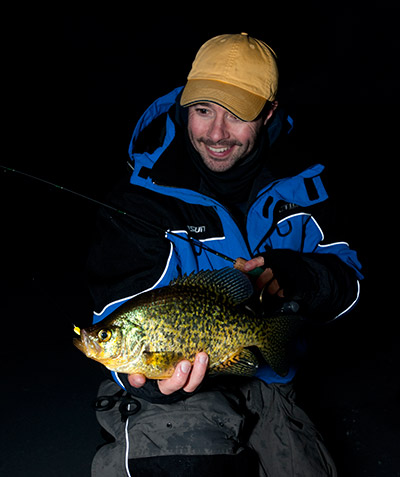 The author with a crappie coaxed to bite using a Custom Jigs & Spins Poppee teardrop jig.