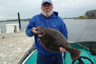 Ken Morse of Wall with a 7.5-pound fluke he caught on the opening day of fluke season.