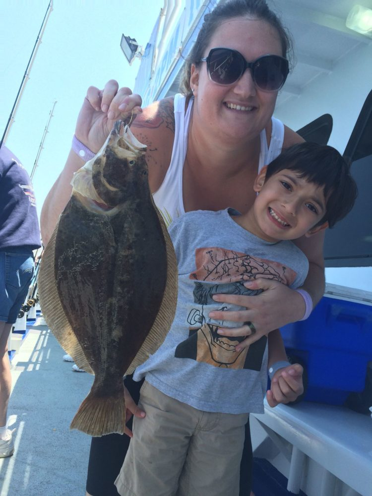 Fluke fishing has been fun for all ages this week. Here's a happy family with a keeper caught aboard the Norma K III