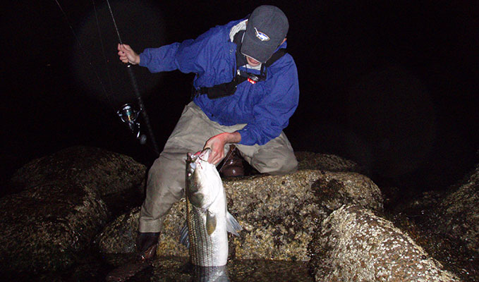 After hours fall surf stripers on the water for Massachusetts saltwater fishing license