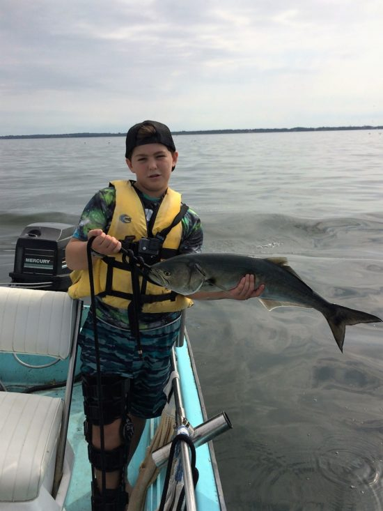 Owen Duvel holds a big bluefish caught from his family's 1964 Whaler.