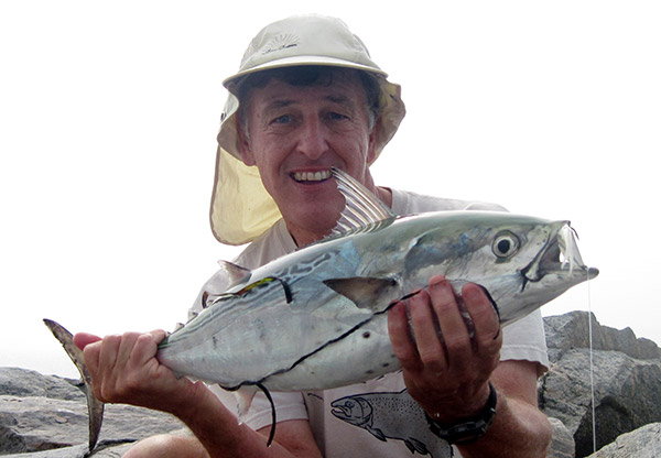 The author holds up a false albacore that he caught from a jetty