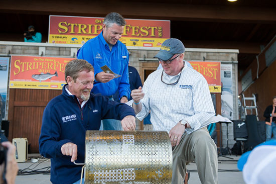 Yamaha's Dave *LNAME* and Century Boats's *NAME* dig through the Golden Tickets to select the 2016 StriperCup grand prize winner.