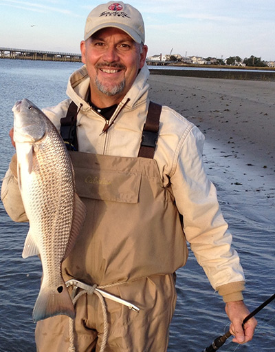 Fred Riddel waded a back bay sand flat to encounter this red.