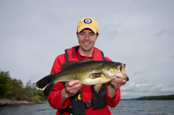 The author with an autumn largemouth taken from a lake tributary.