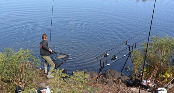 Angler Pavel Hastik netting a big carp