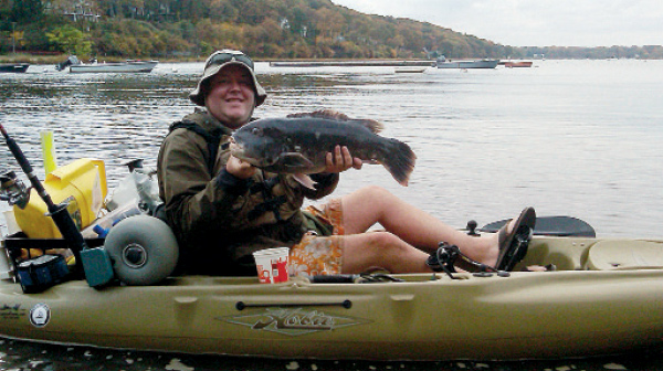 The author with a big tautog taken in shallow water.
