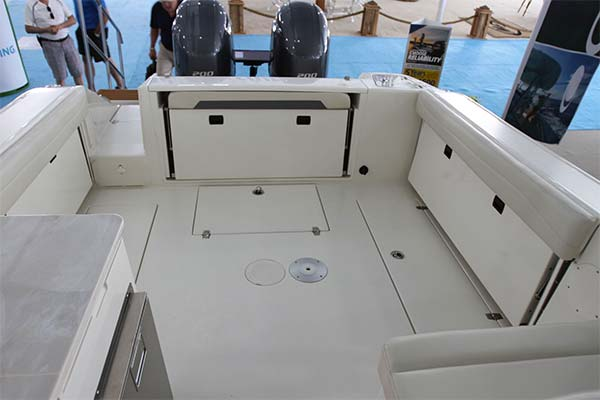 All aft bench seating hides away under hinged covering boards making for a wide open cockpit free of any snags or concerns of damaging the cushions when fishing. Note the standard insulated 47 gallon fishboxes in the floor that can be macerated to pump overboard.
