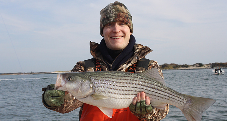 Locating the warmest water is the key to catching the first stripers of the season.