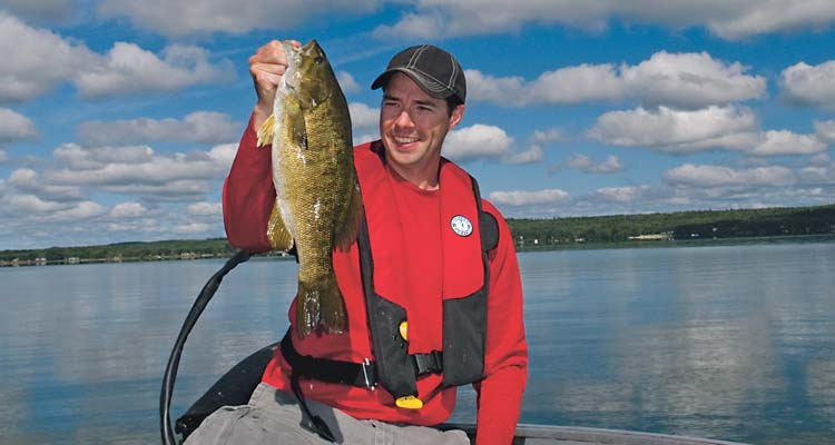 This summer smallmouth was found on a few small humps in 35 feet of water.