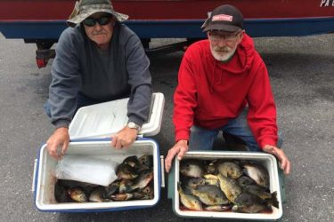 Roland W. Slusser of Bloomsburg, PA (L) and Robert A. Roan of Orangeville, PA proudly displaying their catch of Bluegills they caught while fishing at Mauch Chunk Lake.