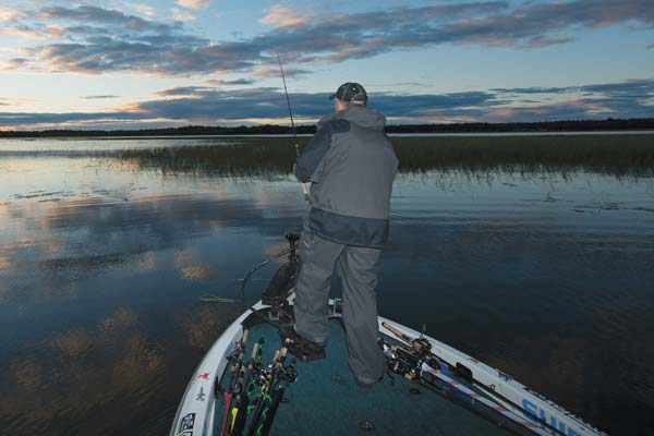 Craig Lister works a shallow bay at dusk, swimming a Jackall Ammonite Shad.