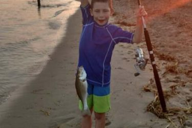 Ryan Johnson, 8 years old, caught many stripers on clams at the mouth of the Merrimack River.