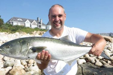 Nick Pacelli holds a big bluefish.