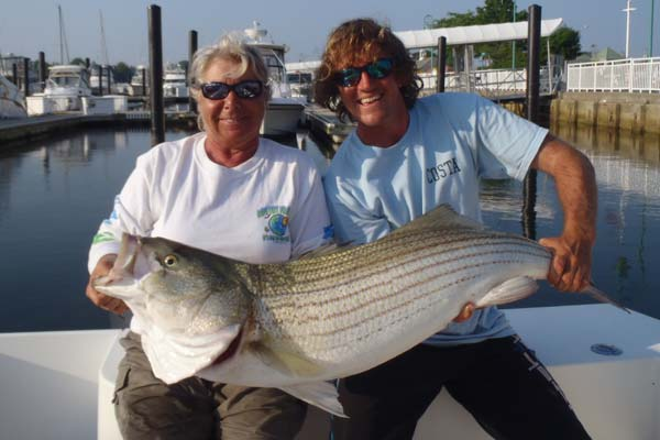 Maureen Klause holds the 4-pound-test line class record for striped bass