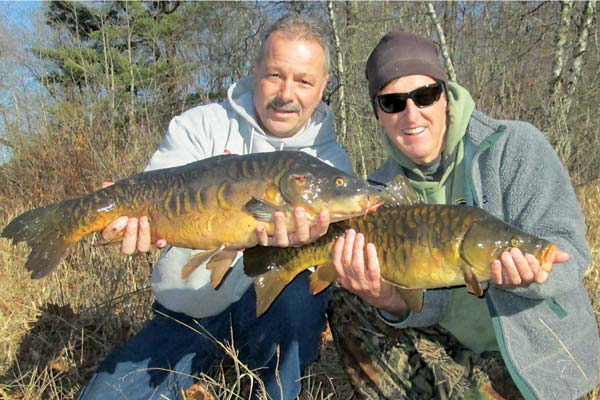 two friends with a couple of mirror carp