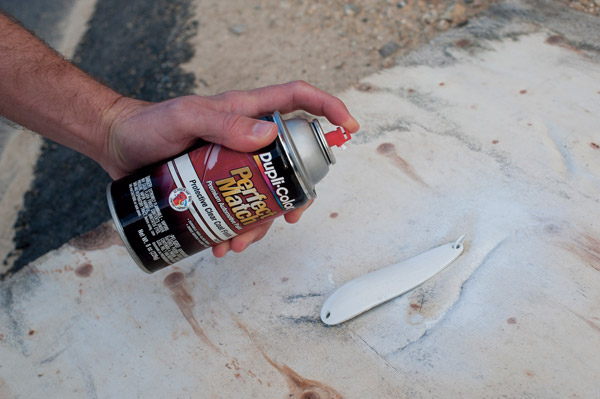 Spray-paint the spoon with several coats