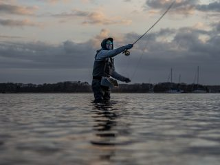 Kevin Blinkoff searching for stripers with a fly rod in early May.